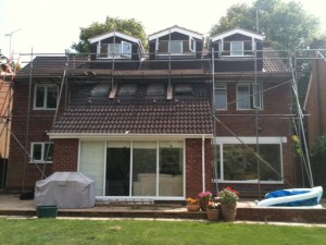 triple rear pitched roof dormers